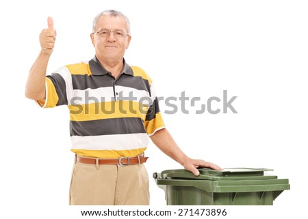 Satisfied senior standing by a trash can isolated on white background - stock photo