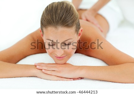 Satisfied woman enjoying a massage in a spa center
