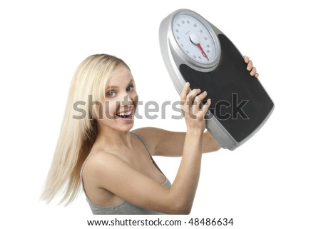 Satisfied woman raising her scale - stock photo