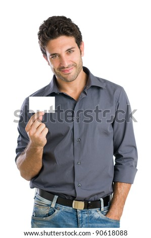 Satisfied young beautiful man holding and showing blank card ready for your text