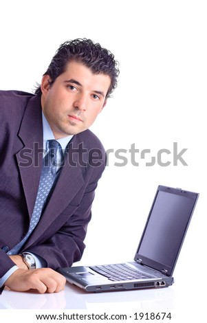 Satisfied young businessman with a lap top computer against white background