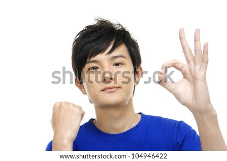 Satisfied young man showing okay sign - stock photo