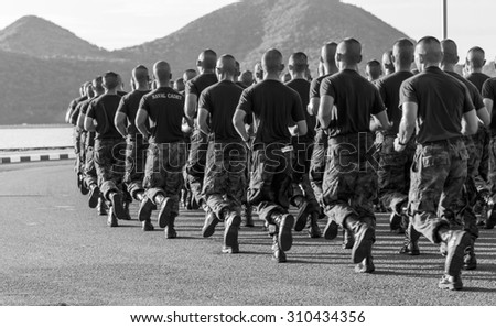 SATTAHIP CHONBURI - AUGUST , 27 : A group of Royal Thai Naval Cadets  run together in row along the beach road at Marine corp department . THAILAND AUGUST,27 2015 - stock photo