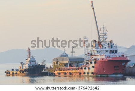 SATTAHIP CHONBURI - FEB,14 : Harbor Tugs on standby for towing operations of cargo ship in port.THAILAND FEB,14 2016