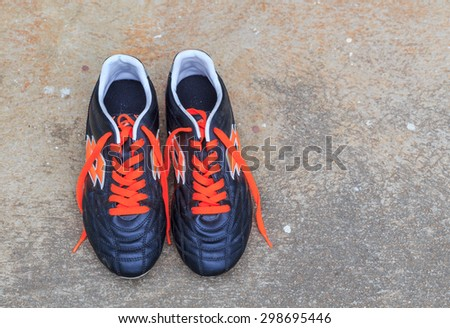 SATTAHIP CHONBURI-JULY,22 : A colorful Pair of Lotto Football shoes on a concrete floor.THAILAND JULY,22 2015 - stock photo