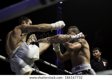 SATTAHIP, THAILAND- APRIL 6 : Between the punch  in Thai Fight : Muay Thai..World's  between Yodsanklai Fairtex VS Diogo Alado on April 6, 2014 at King of muay thai , Chonburi , Thailand - stock photo