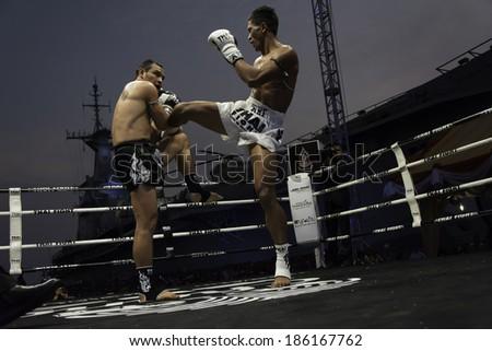 SATTAHIP, THAILAND- APRIL 6 : Between the punch  in Thai Fight : Muay Thai..World's  between Saiyok Pumpanmuang VS Chanajon p.k.Sandchai Muay Thai Gya on April 6, 2014 , Chonburi , Thailand - stock photo