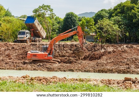 SATTAHIP , THAILAND - JULY 25, 2015 : Backhoe on the construction at digging the pit. Preparatory work for the construction . The work of construction machinery in a quarry , Thailand on July 25, 2015 - stock photo