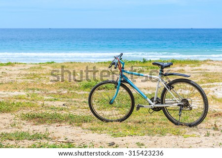SATTAHIP , THAILAND - SEPTEMBER 11 , 2015 : Parked bicycles on the beach in day time in Sattahip , Thailand on September 11, 2015. The weather is very good for bike and relax. - stock photo