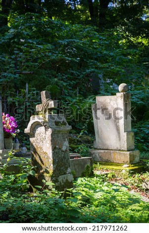 Satue on grave in the old cemetery - stock photo