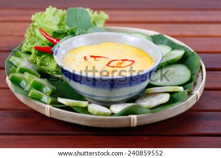 Sauce of macerated  snakehead  steamed with minced pork and egg so called MAM CA LOC CHUNG - typical Vietnamese cuisine. - stock photo