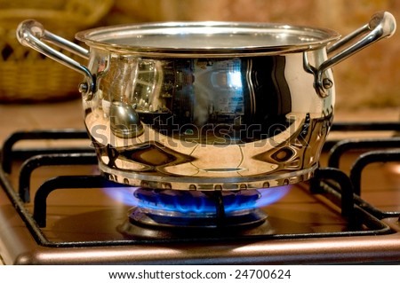 Saucepan on a gas torch - stock photo