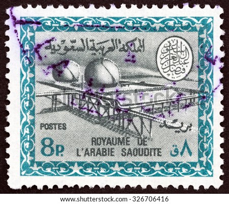 SAUDI ARABIA - CIRCA 1966: A stamp printed in Saudi Arabia shows Gas Oil Plant Cartouche of King Saud, circa 1966.  - stock photo