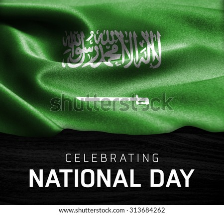 Saudi Arabia flag and Celebrating National Day Typography on wood background - stock photo