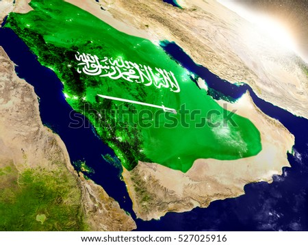 Saudi Arabia with embedded flag on planet surface during sunrise. 3D illustration with highly detailed realistic planet surface and visible city lights. Elements of this image furnished by NASA.