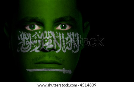 Saudi Arabian flag painted/projected onto a man's face.