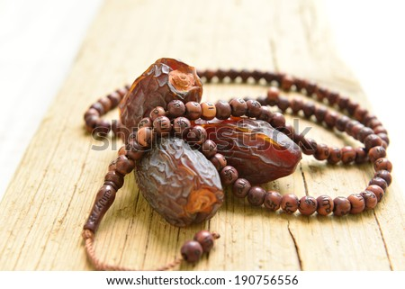 Saudi dates with islamic prayer beads - stock photo