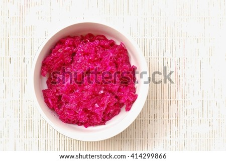 sauerkraut and red beet in the bawl on the white  background, overhead horizontal view - stock photo