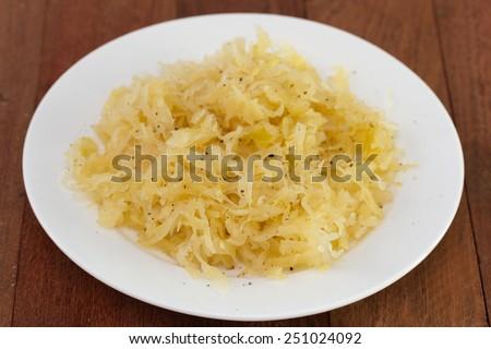 sauerkraut on white plate - stock photo