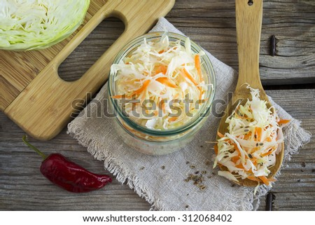 sauerkraut with fennel seeds and red pepper burning, selective focus - stock photo