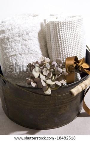Sauna accessories water bucket and towels - stock photo