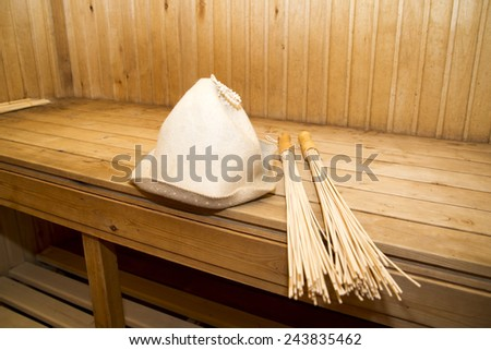 Sauna, bath accessories. Wooden sticks and hat
