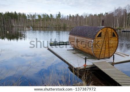 Sauna house on a lake bridge - stock photo