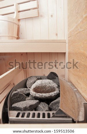sauna oven and thermostat - stock photo