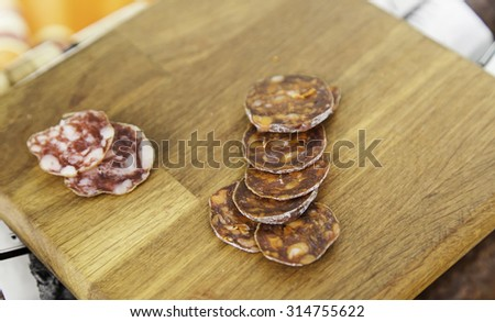 Sausage and cut pepperoni, sausage detail, dried meat - stock photo