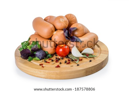 Sausage and spices on wooden board isolated on white background, clipping path without shadow - stock photo