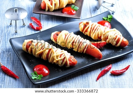 """sausage baked in pastry """"mummy"""" food for Halloween party or children's holiday - stock photo"""