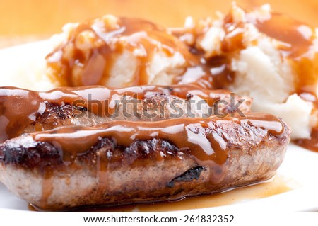 sausage bangers and mashed potatoes, a traditional british pub food - stock photo