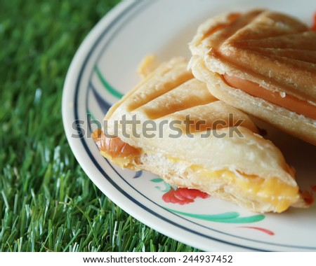 Sausage cheese sandwich. - stock photo