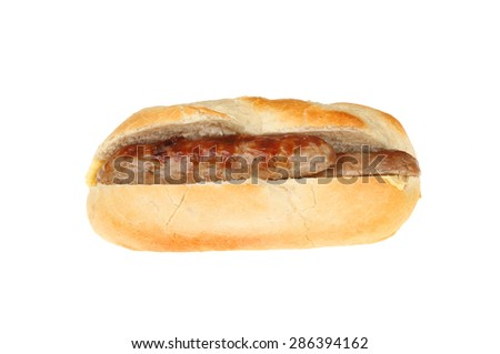 Sausage in a baguette isolated against white