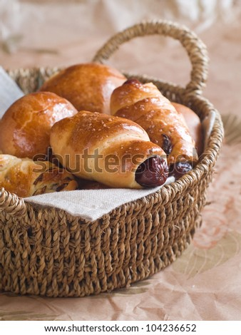 Sausage in dough for  breakfast in basket, selective focus - stock photo