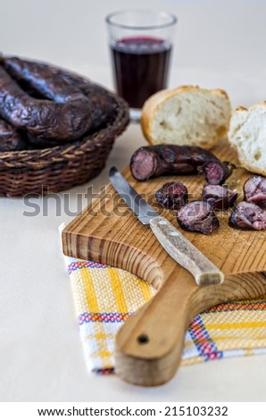 Sausage meat with bread and wine - stock photo