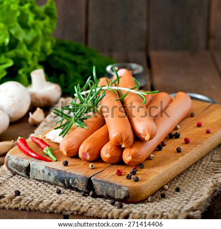 Sausage on a wooden background - stock photo