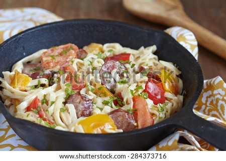 Sausage Pepper Fettuccini Skillet on a table