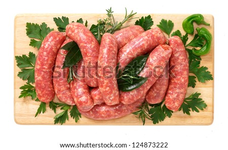 Sausage pork on wooden board - stock photo