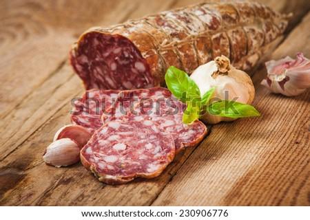 Sausage salami in a rural setting - stock photo