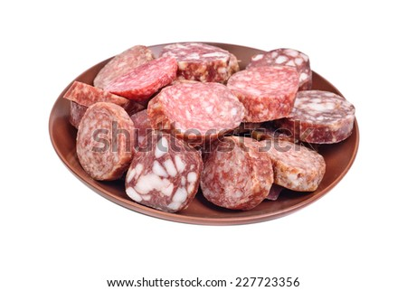 sausage sliced in brown plate isolated on white - stock photo