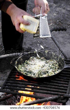 Sausage spinach and egg scramble cooked over a campfire grill