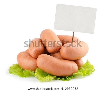 sausages and blank sale tag isolated on white background