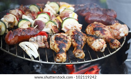 Sausages and chicken on a barbecue
