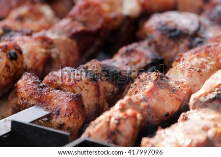 Sausages frying on a grill
