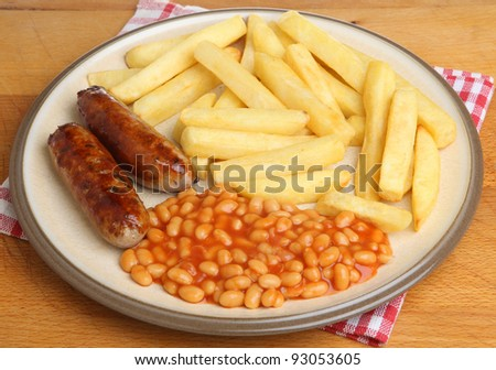 Sausages with baked beans and chips. - stock photo