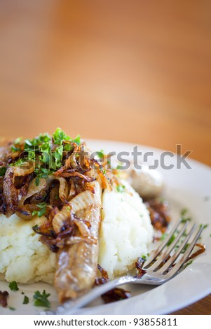 Sausages with mashed potatoes and fried onions at the pub - stock photo