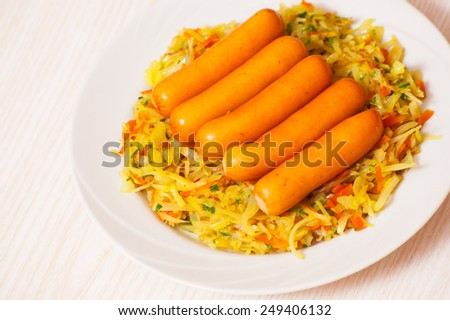 sausages with stewed cabbage - stock photo