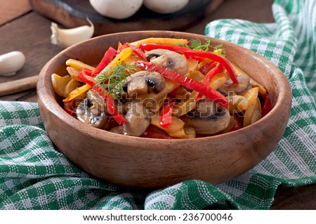 Sauteed mushrooms with pumpkin and sweet pepper - stock photo