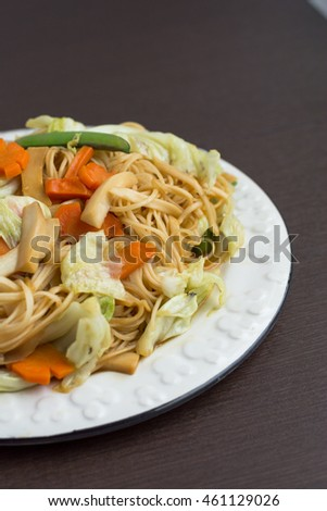sautes mixed vegetables in oyster sauce